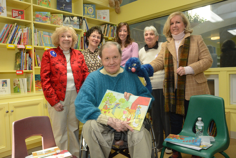 The Children's Adventure Center in Sandy Hook hosted its first Sandy Hook Bookworms storytelling event on Saturday, November 16. Seated in foreground is storyteller Ray Sipherd, and standing, from left, are Mae Schmidle, Mary Steinfeld, Cayenne Spremullo, Marie Smith, and Anne Marie Foran, who is Mr Sipherd's wife.  (Gorosko photo)
