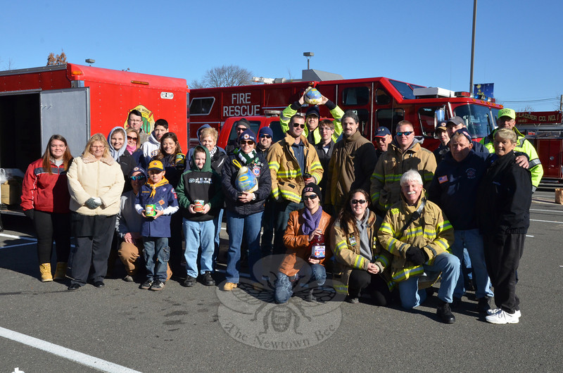 All five of Newtown's fire companies answered the call of Newtown's hungry Saturday, November 23, and gathered donations of food for the FAITH Food Pantry that included 69 turkeys, a ham, more than 115 boxes of nonperishable food, and at least $1,400 in cash and gift cards. Sandy Hook, Hook & Ladder and Hawleyville handled donations at the Big Y.  (Voket photo)