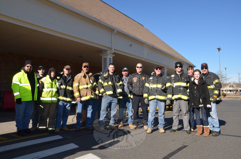 All five of Newtown's fire companies answered the call of Newtown's hungry Saturday, November 23, and gathered donations of food for the FAITH Food Pantry that included 69 turkeys, a ham, more than 115 boxes of nonperishable food, and at least $1,400 in cash and gift cards. Dodgingtown and Botsford volunteers staffed collections at both doors of Stop & Shop. (Voket photo)
