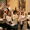 Nearly three dozen children showed up to be part of the children's choir for the Interfaith Thanksgiving Gathering on Sunday night. Trinity Music Minister Fiona Smith Sutherland put the young singers through vocal and physical exercises during a brief rehearsal before the service.  (Hicks photo)