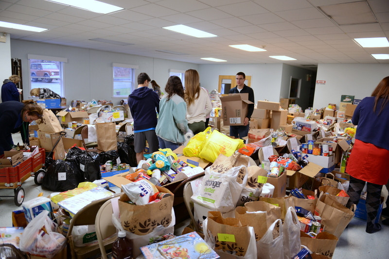 The downstairs hall at Newtown United Methodist Church was filled with goods ready for delivery to as many as 81 families in need this year. Women Interested in Newtown (WIN) members and Newtown High School student volunteers prepared the Thanksgiving baskets that were delivered that day.   (Bobowick photo)