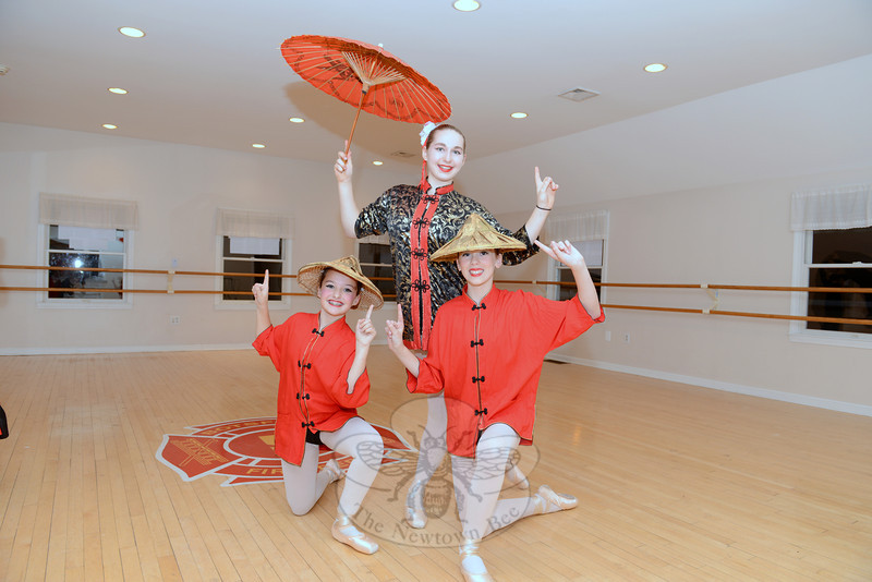 Kylee Raiano, Monique Dubois and Julia Finegan, dressed in Chinese costumes, rehearse for the upcoming performances of The Nutcracker Suite on December 1. Newtown Center of Classical Ballet will return to Edmond Town Hall to participate in this year's Holiday Festival, which will take place on Sunday, December 1. Additional events will be within the former town hall building, at C.H. Booth Library, and along Main Street with the addition of narrated trolley tours. The event is a fundraiser for Newtown Youth & Family Services.   (Bobowick photo)