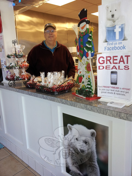 Owner John Martin stands behind the counter at his Frosty Bear Ice Cream Shop, located on Route 25 about a mile south of the Newtown-Monroe border in Monroe, adjacent to Creative Music. Mr Martin is not letting winter weather keep him from serving up fresh creamy treats to his customers, especially since many of his competitors have closed for the season.     (Voket photo)