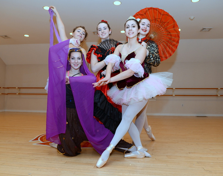 In front are Morgan Cebry as the Arabian knight and Jenna Siroky as a Sugar Plum Fairy. In back, from left, are Vianna Schappach, Riley Smith, and Monique Dubois with her parasol.    (Bobowick photo)