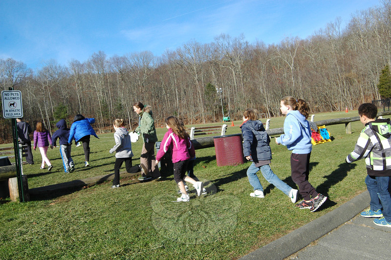Sandy Hook Elementary School's annual Turkey Trot was held on Wednesday, November 20. Physical Education teacher Jaclyn Lloyd, center, led students at the start of the trot.   (Hallabeck photo)