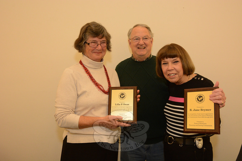 At the November 21 meeting of the Planning and Zoning Commission (P&Z), two longtime members of the land use agency who are leaving the P&Z received awards for their service. Neither member sought reelection in November. P&Z Vice Chairman Robert Mulholland, center, presented plaques to Lilla Dean, left, who was a P&Z member since 1997 and served as its chairman since 2007, and to Jane Brymer, who joined the group in 2002. The women also received awards from First Selectman Pat Llodra at the session. Both women will be replaced by new members when the P&Z next meets on December 5.   (Gorosko photo)