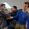 Coordinating more food into recipients' baskets were, from left, Ryan King, Brendan Grant, Curtis Giles, Kurnal-Marwah, and Matt Perun, many of the young men volunteering for a second year or more in the WIN effort.   (Bobowick photo)