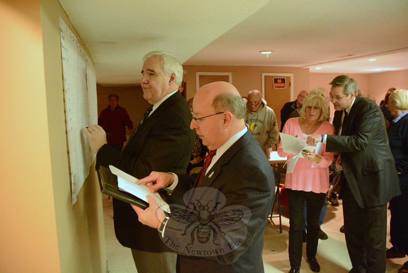 Democrats Herb Rosenthal, left, and Alan Clavette post the results from the November 5 municipal elections at VFW Post 308, where the Democrats had gathered after the voting. Checking some voting results, at right, are Maureen Crick Owen and James Gaston, Sr. (Gorosko photo)