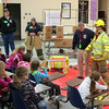 Eleven firefighters from Sandy Hook Fire & Rescue spent Friday, October 25, at Sandy Hook School. Firefighters took one of the company's engines to Chalk Hill School in Monroe for the annual Fire Prevention presentations. All students had time with the firefighters that Friday, learning lessons that will hopefully stay with them and keep them safe for the rest of their lives. Engineer Rob Sibley led each presentation, which was adjusted for the different grade levels. He was backed by his fellow firefighters in explaining gear, equipment, the importance of checking batteries in home fire alarms, and the importance of having a safe place to meet in the event of an emergency in the home. Students also had the opportunity to head outdoors for a few minutes to explore the fire engine before returning to class. (Hicks photo)