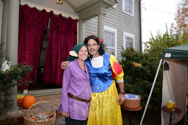 Longtime Main Street resident Lucy Sullivan prepared for 3,300 Halloween visitors last week, but tells The Newtown Bee she did not go through all of her candy this year. Many of her neighbors prepared for 2,000 visitors and did run out, around 7 pm, after trick or treaters descended upon Main Street for the first full Halloween celebration since 2010. Halloween in town had been all but cancelled in 2011 after Winter Storm Alfred dropped heavy, wet snow across the region and created dangerous settings for the autumn holiday. Last year it was Superstorm Sandy that diminished the season's spirits, causing town officials to ask residents to wait until November 4 for trick or treating. Last week costumed residents of all ages returned for the seasonal fun, including this crew seen heading up Church Hill Road around 5 pm. After speaking with some of her neighbors, Mrs Sullivan estimates approximately 2,500 guests visited some of the Main Street homes this year. (Bobowick photo)