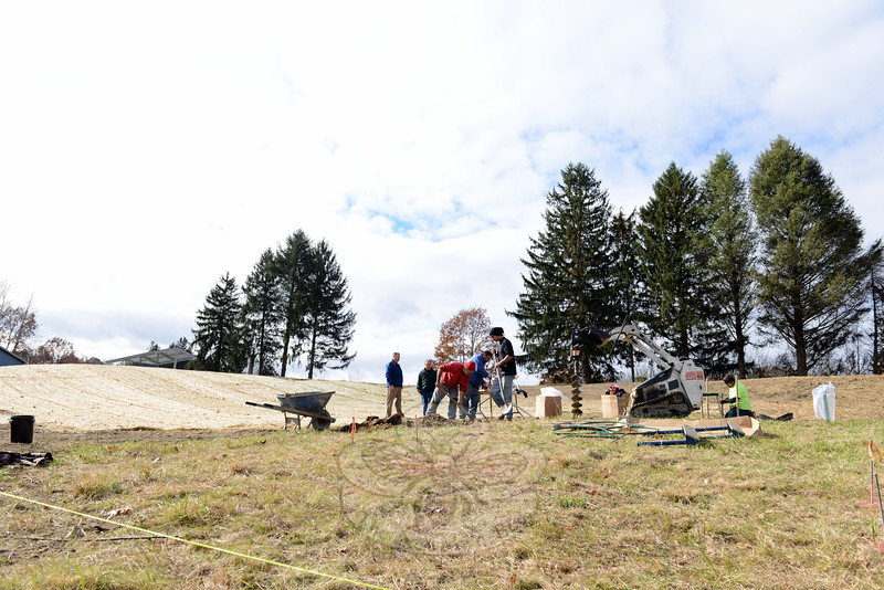 Parks and Recreation crew member Jim Tani hauls away debris as town crews trim trees on property bordering the site of Newtown's new Park and Bark dog park, which should be ready to welcome canine friends this spring. Park and Bark, which will include water features, will be an off-leash park for dogs. Recreation members also completed additional site work at the Old farm Road parcel this week. (Bobowick photo)