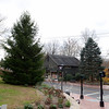 Looking toward Sandy Hook Center from the end of Riverside Road, with Washington Avenue running to the left, a recently planted mature fir tree now stands, left. The new tree overlooks The Glen, a Newtown Forest Association property across the street beside Sabrina Style. The evergreen there, which will come down at a future date, is traditionally decorated for an annual tree lighting ceremony. Both trees will be lit during this year's December 7 celebration. (Bobowick photo)