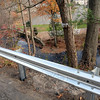 Workers from the Atlas Guardrail & Fence Company of Branford this week installed about 900 linear feet of metallic flex-beam guardrailing along the eastern edge of Dayton Street in Sandy Hook Center. There are some very high, steep dropoffs along the edge of the road leading down to the river. The metallic guardrailing replaces some old rotted wooden-post and steel-cable barriers that stood along the road's edge. (Gorosko photo)
