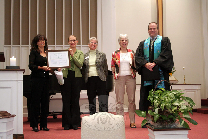 Newtown Congregational Church received a Green Church Certificate from the Connecticut Conference Environmental Ministry Team during worship service on Sunday, September 29. The mission of the ministry team is to engage churches of the Connecticut Conference, United Church of Christ, in an active program of caring for the planet through environmental stewardship. The team has been working since 2008, when a resolution was adopted by all UCC churches to reduce their carbon footprint. On September 29, Diane Lauricella, a member of the team, visited Newtown Congregational Church to present a certificate to recognize that NCC has finished the first of three steps to needed to become recognized as a Green Congregation. From left is Barbara Donahue, who co-chairs the NCC Green Team with Judy Stowell (not pictured); Ms Lauricella; NCC Green Team members Emi Lydem and Marlene Whitney; and NCC Senior Pastor Matthew Crebbin. The fifth member of the local green team is Peg Daley, who was also unavailable for this photo. Ms Lauricella said on Sunday that New-town Congregational Church is one of approximately 25 churches across the state that have joined the UCC-CT Green Team. Churches receive recognition at each level of the three-level, three step process. (Hicks photo)