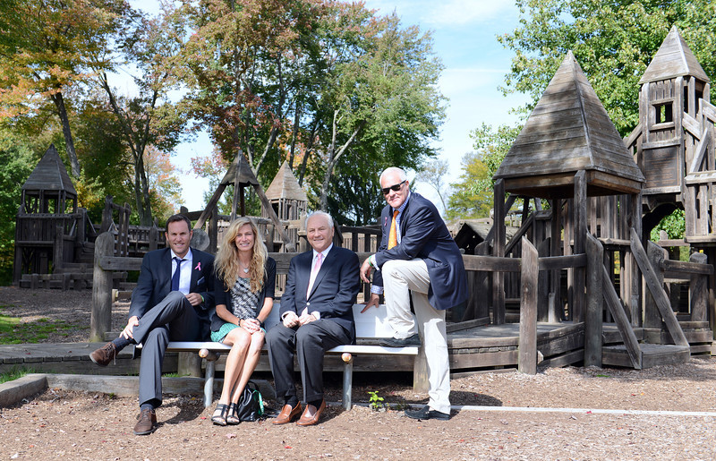Seated with Parks and Recreation Director Amy Mangold, second from the left, are contributors to the new Dickinson Park playground. Seated to Ms Mangold's right is Stuart Frankel, and his sons Andrew, left, and standing is Jeff, of Stuart Frankel & Company Inc. (Bobowick photo)
