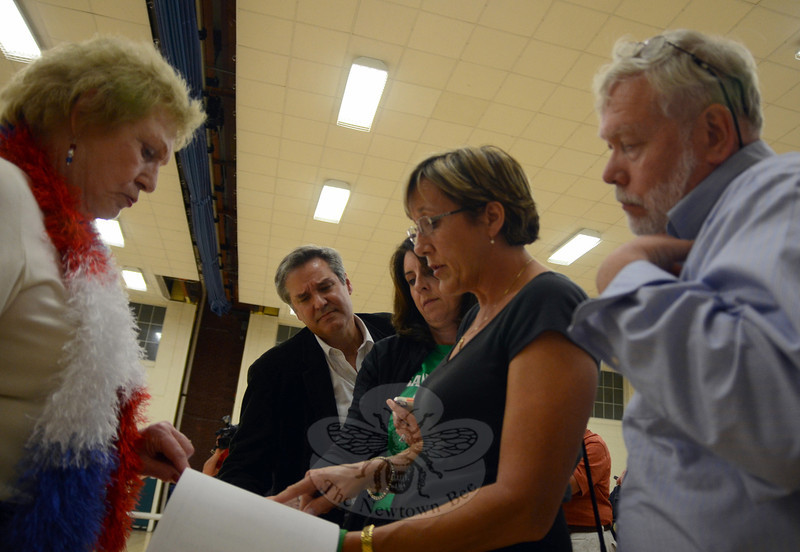 Assistant Registrar Carol Mattegat, left, reviews the hourly ballot totals with Selectman James Gaston, Board of Education Vice Chair Laura Roche, Legislative Council Vice Chair Mary Ann Jacob, and Councilman George Ferguson prior to announcing that the Sandy Hook School referendum had passed by about a 90 percent margin. (Voket photo)