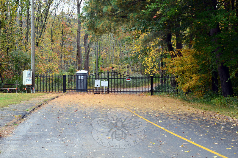 A new security gate has gone up on Dickinson Drive at the former entrance to Sandy Hook School, and the site has been handed off to the construction managers of Consigli Construction according to First Selectman Pat Llodra. Mrs Llodra said remediation of the building is set to begin and no further public access will be allowed on the site. (Voket photo)