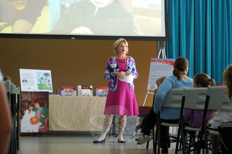 Glenna C. Orr, director of Kind Kids, Inc, a nonprofit organization, spoke to St Rose of Lima School students on Tuesday, September 24, about her organization and her published books. (Hallabeck photo)