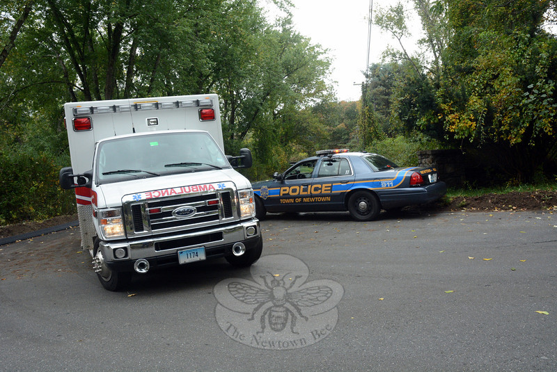 A Newtown Volunteer Ambulance Corps vehicle leaves Jo-Mar Drive and enters Riverside Road on Monday, October 7, as it heads to Danbury Hospital, transporting an off-duty male Norwalk police officer who had been threatening to harm himself at his wife's home on Jo-Mar Drive.  (Gorosko photo)