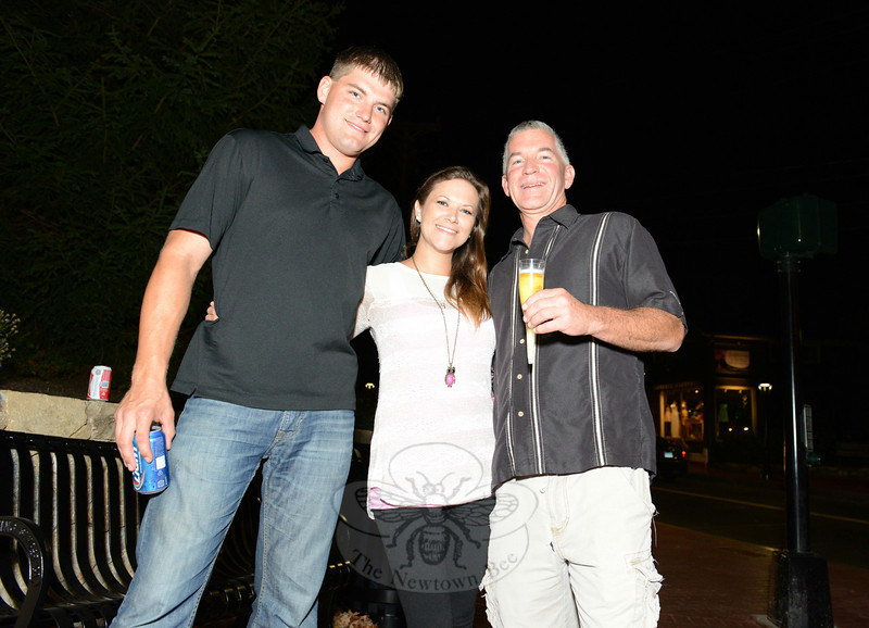Ryan Clark, left, shares a toast with Katelynn Murray and Mike Burton at the Sandy Hook Center Streetscape lamp lighting celebration, Friday, October 3. (Bobowick photo)