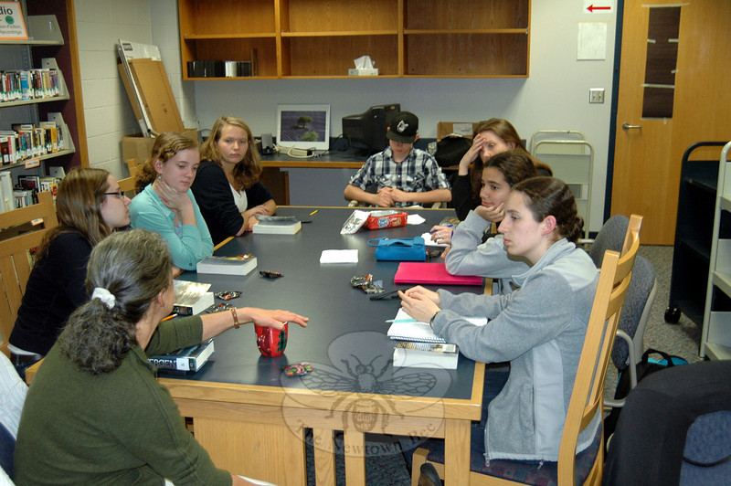 The Newtown High School Book Club met Monday, September 30, in the school's library/media center to discuss its most recent book, Divergent by Veronica Roth. (Silber photo)