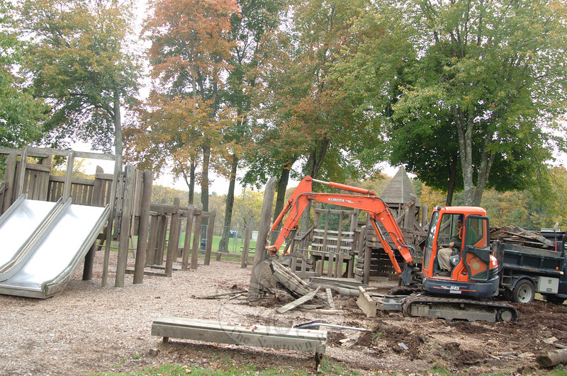 Jim Tani works the gears to grip and toss razed play features at Funspace into the back of a dump truck Thursday, October 10. The Dickinson Park playground, built in 1989, will be replaced by a new interactive play area. (Bobowick photo)