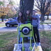 Newtown Middle School students, from left, Maddy Albee, Cate Norton, and Dani Powell depicted the character of Mike from the movie Monsters Inc as a square, rather than the character's usual round shape. (Silber photo)