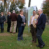 With half the playground at Dickinson Park razed behind them, and a sign displaying the future playscape nearby, a small gathering of officials and playground supporters held a new Dickinson Memorial Park Playground groundbreaking ceremony Tuesday, October 22. Interim Superintendent of Schools John Reed, far right, talks with Jennifer and Neil Chaudhary. (Bobowick photo)