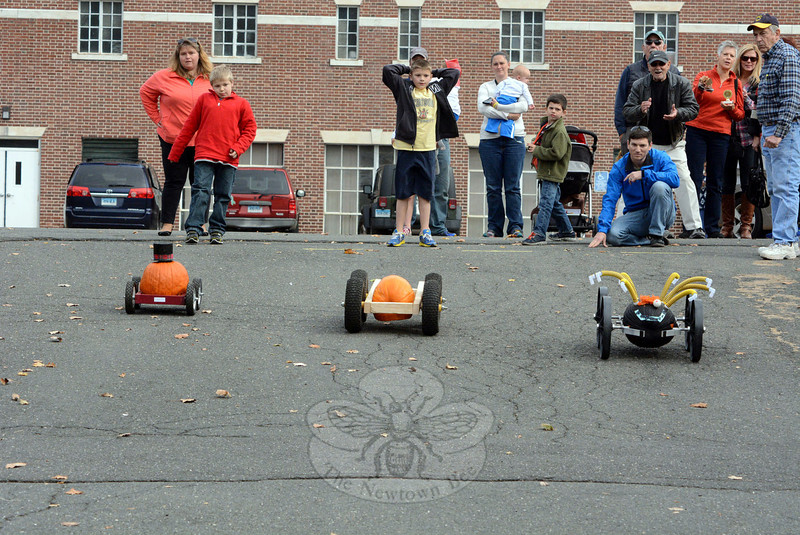 Participants at the 4th Annual Great Pumpkin Race held their collective breath on Saturday, October 19, as their colorful, wheeled gourds rolled down a slope in a tight race in the parking lot behind Edmond Town Hall. Participants also competed in pumpkin decorating contests. The Newtown Lions Club sponsored the event as a fundraiser for its charitable work. (Gorosko photo)