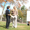 With half the playground at Dickinson Park razed behind them, and a sign displaying the future playscape nearby, a small gathering of officials and playground supporters held a new Dickinson Memorial Park Playground groundbreaking ceremony Tuesday, October 22. Landscape architect, resi-dent, and new playground designer Billie Cohen talks with Parks and Recreation Director Amy Mangold. (Bobowick photo)