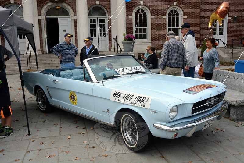 The Newtown Lions Club raffled off this 1965 powder blue Ford Mustang convertible on Saturday, October 19 on the plaza in front of Edmond Town Hall. The car has a 289-cubic-inch V-8 engine, 3-speed automatic transmission, power steering, power brakes, and a newly reupholstered interior. The Lions sold approximately 10,000 tickets at $10 each for the raffle. The club uses the funds for its charitable projects.  (Gorosko photo)