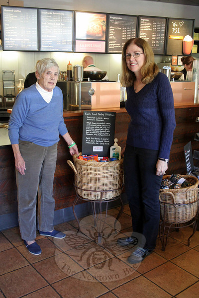 A small collection basket has been placed inside Starbucks on Church Hill Road. Customers are encouraged to donate items for FAITH Food Pantry, which will be picked up and delivered to the food pantry by members of Women Involved in Newtown. FAITH Co-Chair Lee Paulsen, left, met recently with WIN member Corey Kondas, who had the idea for the new project for the club. (Hicks photo)