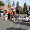 Tension mounted at the starting line of one of the heats of the Fourth Annual Great Pumpkin Race in the parking lot behind Edmond Town Hall on Saturday, October 19. The annual event, sponsored by the Newtown Lions Club, drew a colorful variety of racing pumpkins this year, and the competition was keen. (Gorosko photo)