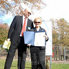 With half the playground at Dickinson Park razed behind them, and a sign displaying the future playscape nearby, a small gathering of officials and playground supporters held a new Dickinson Memorial Park Playground groundbreaking ceremony Tuesday, October 22. Landscape architect, resident, and new playground designer Billie Cohen talks with Parks and Recreation Director Amy Mangold. (Bobowick photo)