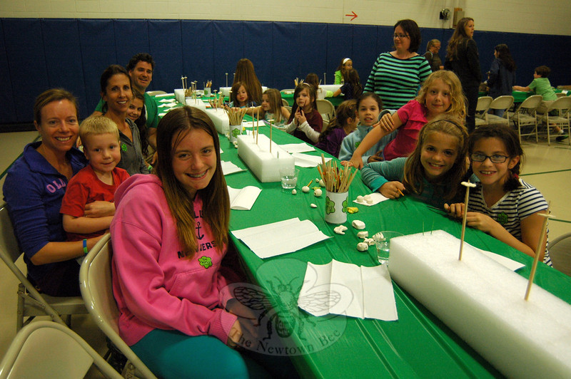 A group of Hawley Elementary School students and family members gathered at one of the tables available on Friday, October 18, for an evening event to create and paint Ben's Bells. (Hallabeck photo)