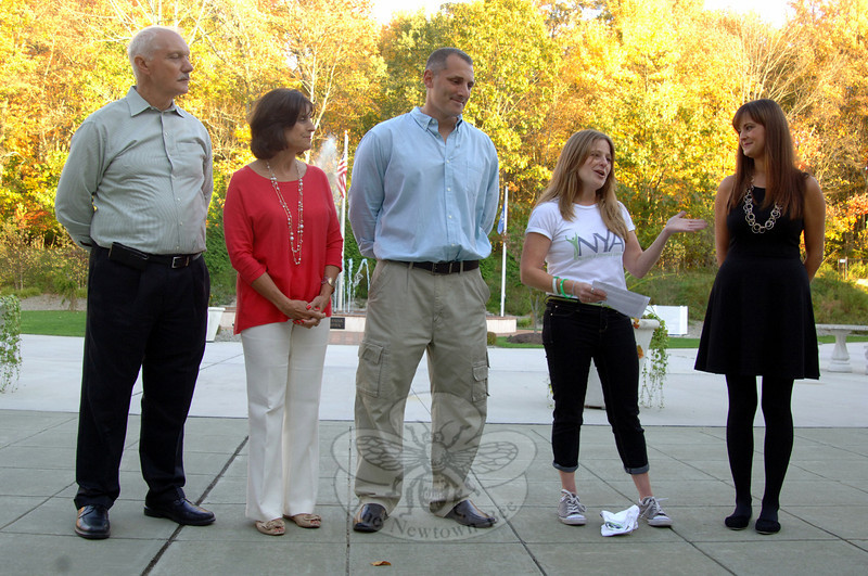 On Friday, October 18, during its fifth anniversary celebration, the NYA staff unveiled muralist Nichole Blackburn's donation of artwork covering the recreation and community facility's walls. Standing with NYA Founder Peter D'Amico, left, are from left,  Co-directors Dorrie Carolan, Cody Foss, Director of Communications Alisa Farley, and visiting artist Nichole Blackburn. (Bobowick photo)