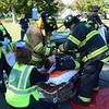 At the Newtown Health & Public Safety Fair, Botsford Fire Rescue Company volunteers, as well as volunteers from other local fire companies, and members of the Newtown Volunteer Ambulance Corps staged a simulated extrication of a person involved in a serious motor vehicle accident. (Gorosko photo)
