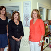 From left, Kim Weber, Booth Library young adult librarian, Kim Killoy, Drug Free Communities grant coordinator, and Judy Blanchard, district health coordinator and co-chair of the Newtown Pre-vention Council, meet at The Parent Corner on the third floor of the CH Booth Library to plan the group's upcoming Parent Speaker series. (Voket photo)