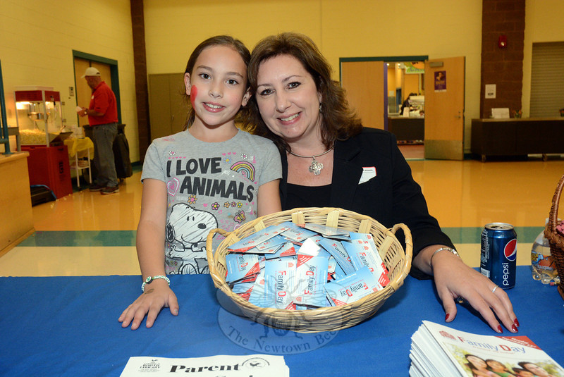 Kim Killoy and her daughter Karly are seen at Family Dinner & Fun Night at Reed Intermediate School on September 27. Ms Killoy is the drug-free communities grant coordinator for Newtown Pre-vention Council. (Gorosko photo)