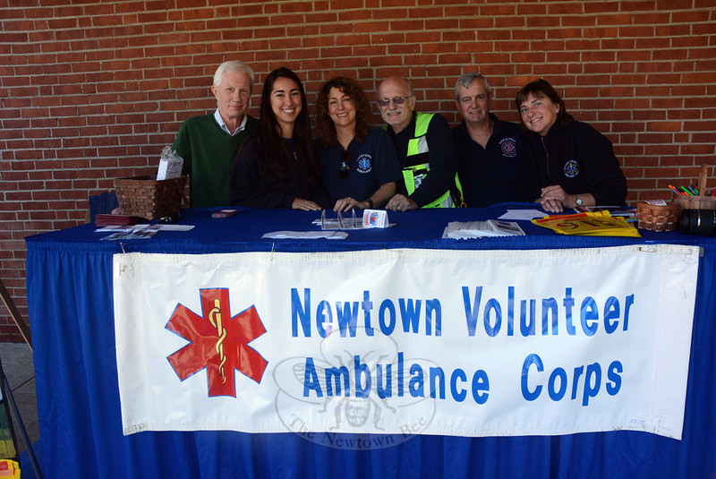 Local ambulance volunteers were well represented at the Newtown Health & Public Safety Fair. Shown, from left, are Bruce Herring, Sarah Milas, Laurie Veillette, Ken Lerman, Joe Farrell, and Kris Peterson. (Gorosko photo)