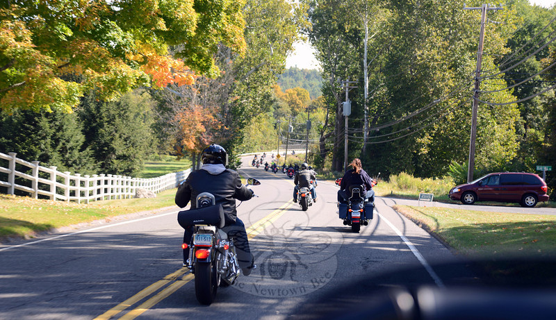 Fourth Annual Firehouse Riders pass through farmland and open fields during their ride route. (Bobowick photo)