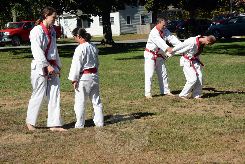 Members of the Newtown Moo Duk Kwan group demonstrated their Korean form of martial arts on the front lawn of Newtown Middle School at the Newtown Health & Public Safety Fair. (Gorosko photo)