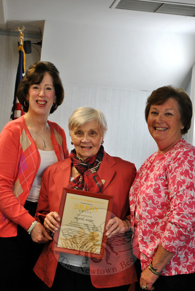 Newtown Meals On Wheels volunteer Ingrid Meier, center, displays the Birthe Melville Award she re-ceived Tuesday, October 1. With her are Meals On Wheels Co-Presidents Pat Barrett, left, and Marg Studley. The Birthe Melville Award is given to a volunteer who has shown dedicated service to Meals On Wheels for an extended period of time, said Ms Barrett. Ms Meier has been a committed driver for the program since 1984. Making the honor even more special, Ms Meier said, is the fact that Birthe Melville, a former Meals On Wheels president, was one of her best friends. Meals On Wheels continues to seek drivers. Volunteers deliver meals just once a month, committing about an hour of their time. To volunteer, contact Colleen Honan at 203-426-0714. (Crevier photo)