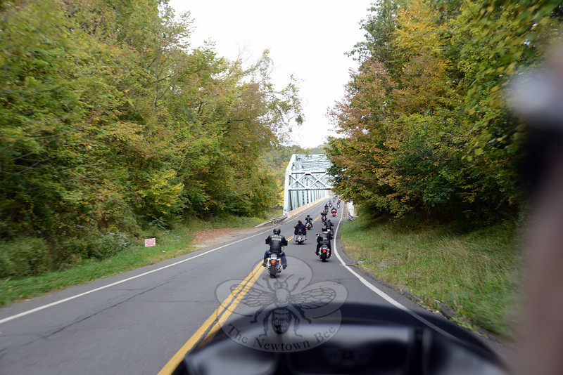 More than 100 motorcycles toured Newtown and five area towns as part of the Fourth Annual Firehouse Ride, benefiting Newtown Hook & Ladder's campaign to raise funds for a new firehouse. The riders shown here are heading across the Lillinonah bridge from Brookfield into Bridgewater in the middle of the tour. (Bobowick photo)