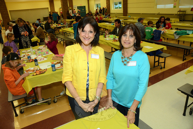 Donna Deluca, left, and Dorrie Carolan, the co-founders of Newtown Parent Connection, Inc., are shown at Family Dinner & Fun Night at Reed Intermediate School on Friday, September 27. The an-nual event is sponsored by NPC and the Newtown Prevention Council to foster positive relations among members of families to improve the social fabric. (Gorosko photo)