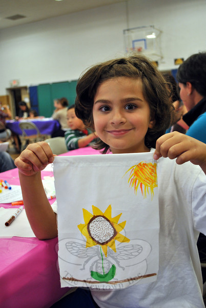 Benjamin Jorno, 7, holds up the sunflower flag he created at the Kids Day of Service event at Edmond Town Hall, Saturday, September 8. (Crevier photo)
