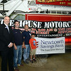 Newtown Savings Bank Manager Ryan Storms, left, stands with Hook & Ladder Fire Company No. 1 member Tim Hoeffel, center, and company chief Ray Corbo and his son Joey. The bank is sponsoring the 2013 Firehouse Ride on September 29, the fourth annual fundraising event that will also benefit the Sandy Hook Family Healing Fund this year. The 50-mile motorcycle ride will start and end at The One-Eyed Pig bar and restaurant at 71 South Main Street. Registration starts at 9 am and the ride leaves at 11 am. A pig roast, raffles, and live entertainment will take place in the afternoon. Cost for riders is $30; passengers, $15; pig roast only, $15. (Bobowick photo)