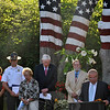 "Honoring those who died 9/11, Newtown Police Chief Michael Kehoe called the day an ""anniversary of tragedy and triumph,"" in remarks made Wednesday morning, September 11, to nearly 100 people, including Newtown State Representative Mitch Bolinsky, gathered on the Route 302 property of former American Stock Exchange trader Howard Lasher. Pictured from left, Chief Kehoe, Newtown First Selectman Patricia Llodra, WestConn President Dr James Schmotter, and artist David Merrill listen as Mr Lasher offers words of hope and  consolation. In opening remarks, Mr Lasher noted, ""On December 14, 2012, we suffered our own 9/11,"" and took time to pay homage to Mrs Llodra, the Newtown Police Department and fire companies, first responders, and all who ""helped our town come together."" In later remarks, Mr Lasher pointed out, ""Twelve years after the 9/11 attacks, we strive to find hope,"" adding that that there are no words, ceremonies, plaques, or tears that will ever return those lost that day. (Crevier photo)"