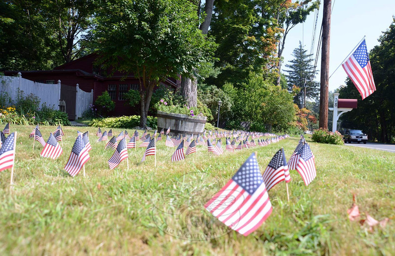 The Bryant residence at 78 Main Street displays a lawn filled with flags Wednesday, September 11. (Bobowick photo)