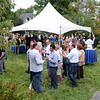 Guests and Kevin's Community Center supporters filled the lawn at George and Shane Miller's house at 50 Main Street Saturday, September 7, for the annual Mozart, Merlot & Mums fundraiser. The evening, which included music, wine, food, and garden tours, serves as the center's main fundraiser. KCC provides free medical services to those who are uninsured or underinsured. (Bobowick photo)